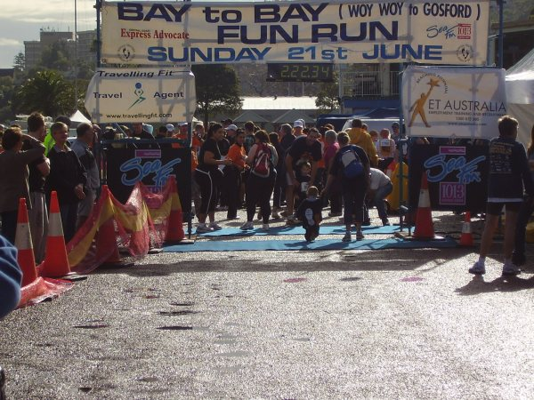 youngest walker-future champion runner crossing the finish line